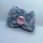 Handknitted pink, purple and mint cup cosie