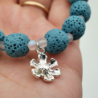 Light blue lava rock and silver plated flower charm stretchy bracelet - small