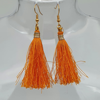 Orange tassle drop earrings