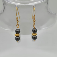 Black and gold haematite drop earrings