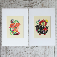 Two handmade cards: Chinese papercuts of a dog and pig
