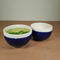 TWO SMALL COBALT BLUE AND WHITE CHINESE TEA BOWLS