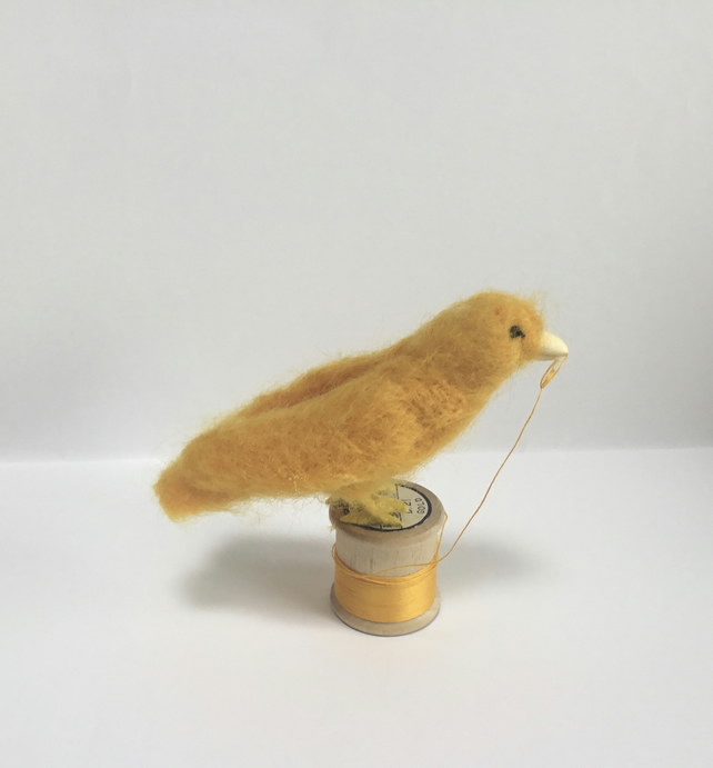 Gold canary on a bobbin
