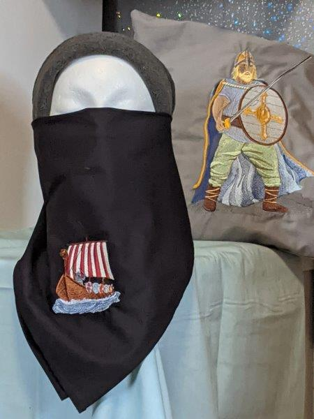 Adult face covering with embroidered Viking Ship motif