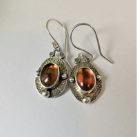 Short drop earrings with amber  - celtic design in recycled sterling silver