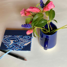 Small notebook with swirly blue cover
