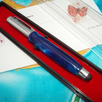 Telescopic Purse Pen in blue acrylic with chrome fittings.