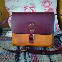 Burgundy and tan leather cross body bag