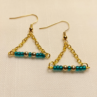 Green and gold coloured earrings