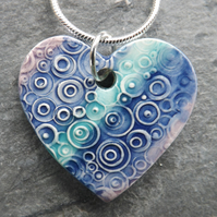 Heart shaped ceramic pendant in turquoise purple and blue