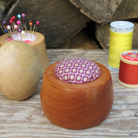 Turned wooden pin cushion in mahogany