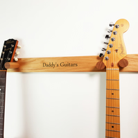 Solid oak, hand crafted double guitar hanger with custom engraved message.