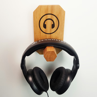 Solid oak, hand crafted, wall mounted headphone hanger. With headphone image