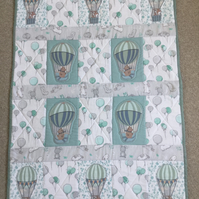 Appliquéd and patchwork baby quilt