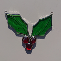 Stained glass holly with three red berries. Copperfoil suncatcher.