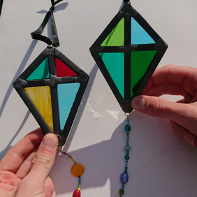 Stained glass leaded multicoloured kite beaded suncatcher. Hanging decoration.