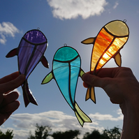 Stained glass purple, turquoise or orange carp fish. Suncatcher decoration.