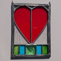 Stained glass bright red heart hanging panel. Copperfoil and lead.