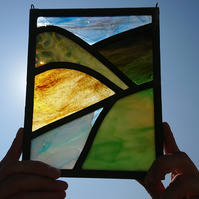 Stained glass leaded panel - green brown hills mountains