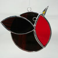 Stained glass stylised bright red robin. Suncatcher hanging decoration.