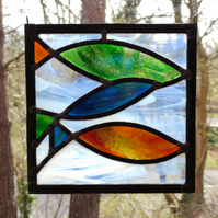 Stained glass leaded blue, orange and green three fish hanging panel