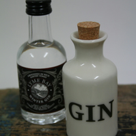 Small porcelain bottle with gin wording