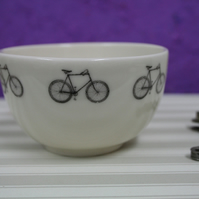 Small porcelain bowl with bicycle motifs
