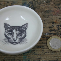 Porcelain dish with cat head motif