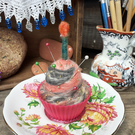 Needlefelted pincushion; on a vintage saucer in a cupcake case with candle