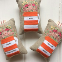 Orange and white personalised lavender bag with hand embroidered flowers