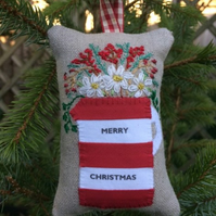 Red and white stripy personalised jug decoration filled with festive spices