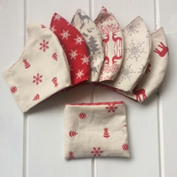 Two mix and match festive face coverings with storage pouch and free postage