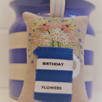 Blue and white personalised lavender bag with hand embroidered flowers