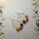 Bright and Bold wood beads wire wrapped hoop earrings.