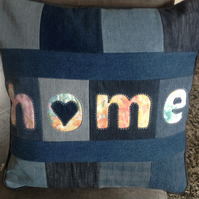 Upcycled denim patchwork and reverse applique 'home' cushion