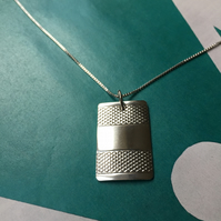 Oblong necklace made from a 1953 Sheffield silver napkin ring