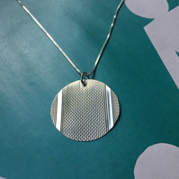 Oval necklace made from a 1938 Birmingham silver cigarette case