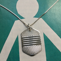 6 sided silver necklace made from a 1953 Sheffield napkin ring