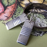 Oblong earrings made from a 1953 Sheffield silver napkin ring
