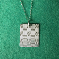 Oblong checkerboard silver necklace