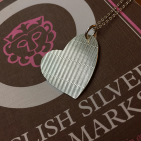 Silver basket weave pattern heart made from a 1930 case