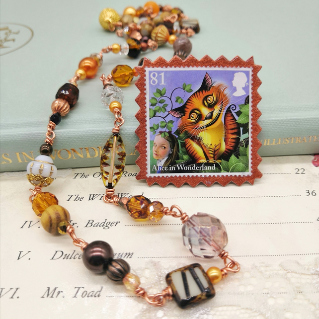 Glass Beaded Necklace with Postage Stamp Pin – Cheshire Cat