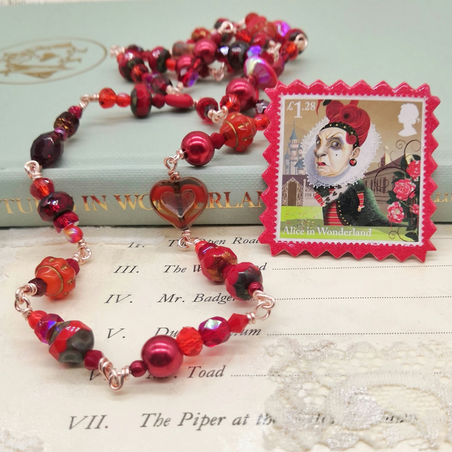 Glass Beaded Necklace with Postage Stamp Pin – Queen of Hearts