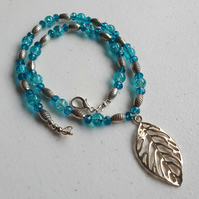 Aqua blue and silver necklace with leaf pendant