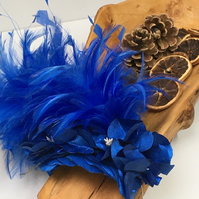 Blue feather fascinator with handmade faux silk orchid flowers