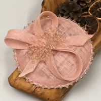 A pale pink button fascinator with pale pink beads and silver wire