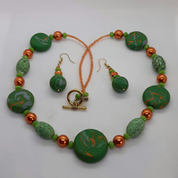 Polymer clay disc shaped necklace and matching earrings