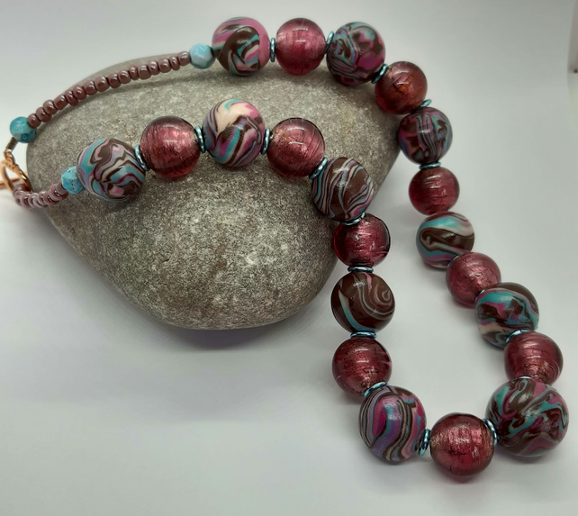 Distinctive polymer clay and glass bead necklace