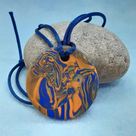 Orange and royal blue polymer clay pendant