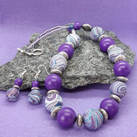 Vibrant purple and teal polymer clay necklace and earrings set